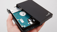 And here we are with the two elements of enclosure pulled apart, and the standard 2.5-inch hard drive finally exposed.