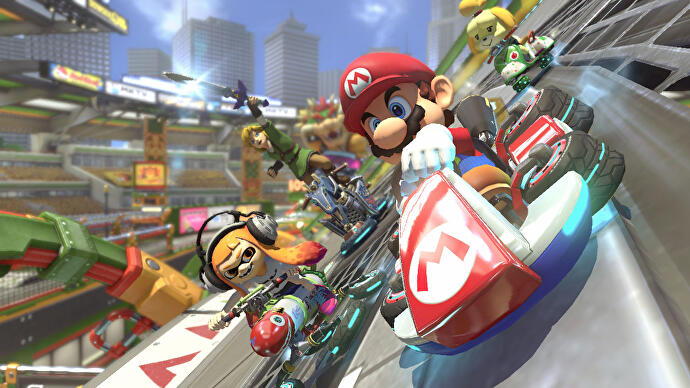 Mario leads Link Inkling and Isabelle in Mario Kart 8 Deluxe race