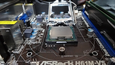 The most crucial point of the process; slotting the 2.8GHz Pentium CPU into the motherboard and clamping it down.