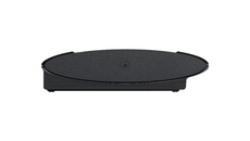 The bottom of the new PlayStation 3 unit. The little PlayStation logo is recessed into the base, and can be removed to reveal a screw hole, into which the base add-on can be attached.
