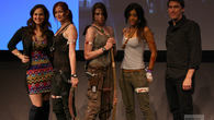 Tomb Raider community manager Megan Marie (left) and senior art director Brian Horton (right) join the two semi-official Lara cosplayers, plus a third from the audience, on stage. That third Lara worked as a volunteer at the Expo, I think. Good work!