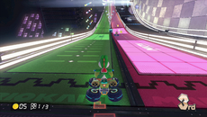 Up close, some of the texture work appears incredibly clean and sharp but much of it is marred by poor texture filtering. Here we can see an inconsistency with the pink side of the track losing much of its detail while the green side remains much sharper.