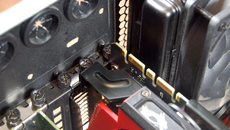 Once the power cables are attached to the new card, don't forget to screw in your new GPU, fastening it to the chassis with the two screws you removed earlier.