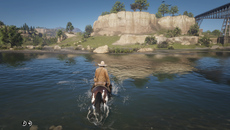 Reflection and refraction is simulated beautifully in Red Dead 2. You can even see the caustics in action below the surface which appear to be tied to movement of the water surface texture.