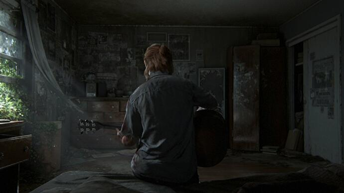 The Last of Us 2's Ellie sitting on a bed playing guitar
