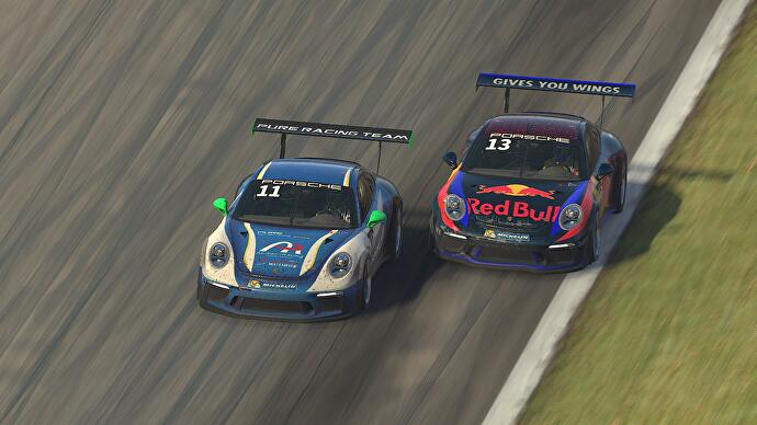 Two Porsche GT cars race side by side in iRacing